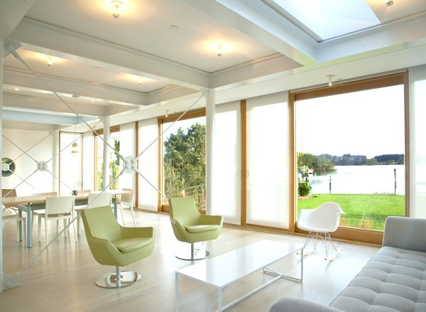 Great room with roller shades pulled Photo 10 of Chesapeake Bay House modern home