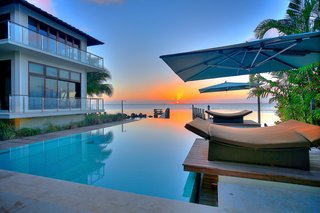 Coastal Contemporary:  10 Modern Seaside Homes - Photo 5 of 10 - Private Oceanfront Vistas: Designed by Deborah DeLeon of Village Architects, this example of modern island fusion is an exclusively private estate. Showcasing magnificent downtown Miami views, escape to this inspiring contemporary waterfront home. Presented by ONE Sotheby's International Realty.