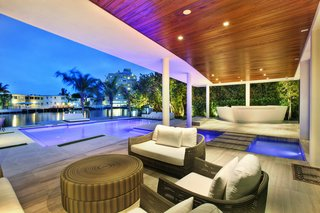 Coastal Contemporary:  10 Modern Seaside Homes - Photo 4 of 10 - Modern Masterpiece with Views of Miami Beach: Designed by Borges & Associates in collaboration with Laszlo Fazekas and LF Development, this modern masterpiece features soaring ceilings, beautiful water views, and fully-gated privacy. Find unrivaled tropical living in the heart of Miami Beach. Presented by ONE Sotheby's International Realty.