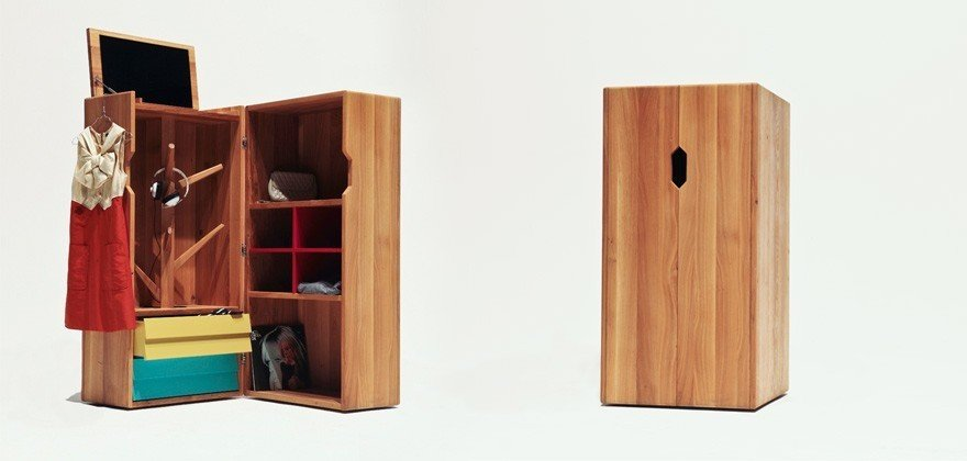 The Trunk features a hat tree, flip-up mirror, cubby holes for shoes or papers, two drawers, and two large shelves for additional storage.