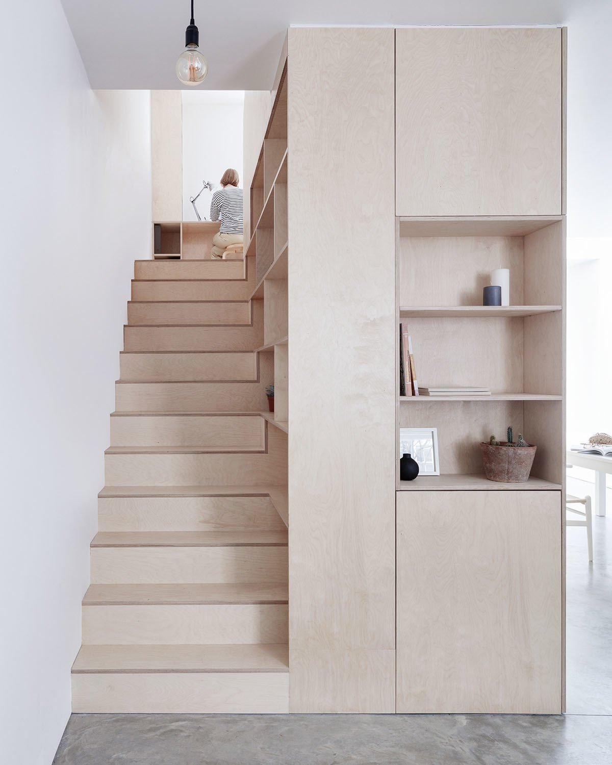 Photo caption: Clean lines in plywood and ample hidden storage give this home a sleek contemporary look. Tagged: Storage Room, Cabinet Storage Type, and Shelves Storage Type.  Photo 3 of 10 in 10 Clever Ways to Sneak Storage Into Your Renovation