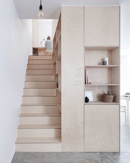 10 Clever Ways to Sneak Storage Into Your Renovation - Photo 3 of 10 - Clean lines, plywood, and ample hidden storage give this home a sleek and contemporary look.