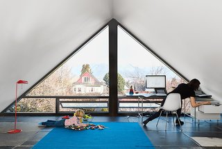 "10 Bright and Airy Modern Attic Renovations - Photo 6 of 10 - ""The city insisted on no flat roofs, so we couldn't do a major correction to make a contemporary house, but they didn't anticipate how we would interpret minimum roof slopes. It's like a Toblerone box."" said the architect, D'Arcy Jones, about the structure."