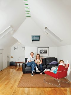 10 Bright and Airy Modern Attic Renovations - Photo 8 of 10 - An upstairs family room converted from an attic was the major perk of this home renovation.