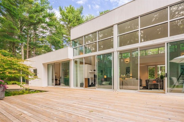 16-foot-high ceilings and dramatic expanses of glass allow light to stream into the open floor plan year-round.
