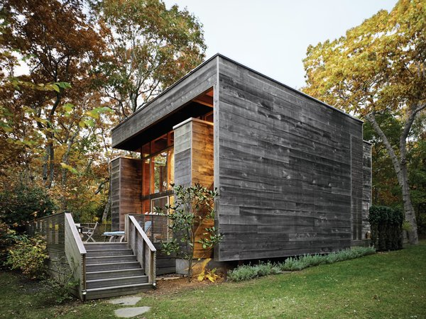 Bates Masi's renovation and expansion of Harry Bates's 1967 house in Amagansett, New York, salvaged much of the home's original cypress decking and incorporated subtle additions to the exterior. Because cypress quickly develops a patina, it was only a matter of weeks before the new facade matched the color of the original wood siding.  Photo 10 of 11 in Spotted: 10 Modern Homes in the Hamptons