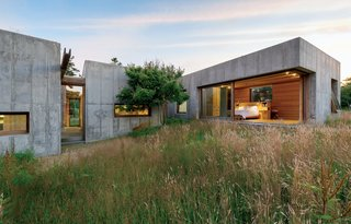 Six modular, concrete boxes comprise a five-bedroom home on Martha's Vineyard, in Chilmark, Massachusetts. Designed with the sloping seaside site in mind, it was built to guard against potential erosion.