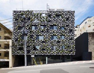 Architect Spotlight: 12 Works by Japanese Architect Kengo Kuma - Photo 7 of 12 - Irrigation and ventilation systems have been installed behind the panels so that the facade can accommodate the building's comprehensive system.