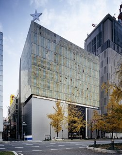 Architect Spotlight: 12 Works by Japanese Architect Kengo Kuma - Photo 4 of 12 - The external walls of the LVMH headquarters in Osaka were fabricated from onyx plates sourced from Pakistan, which were sliced down to four millimeters thick before being sandwiched between glass plates.