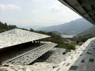 Architect Spotlight: 12 Works by Japanese Architect Kengo Kuma - Photo 8 of 12 - Different kinds of local stones were sourced from a nearby quarry and put together like a mosaic, resulting in an almost pixelated effect.