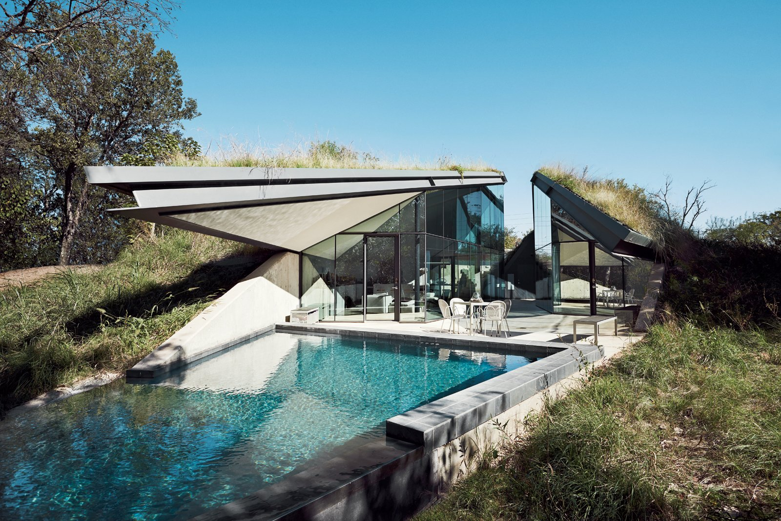 The concrete, steel, and glass house is divided into two distinct public and private halves. Tagged: Exterior and House.  Photo 3 of 12 in These 10 Green Roofs Bring Life—and So Much More—to These Modern Structures