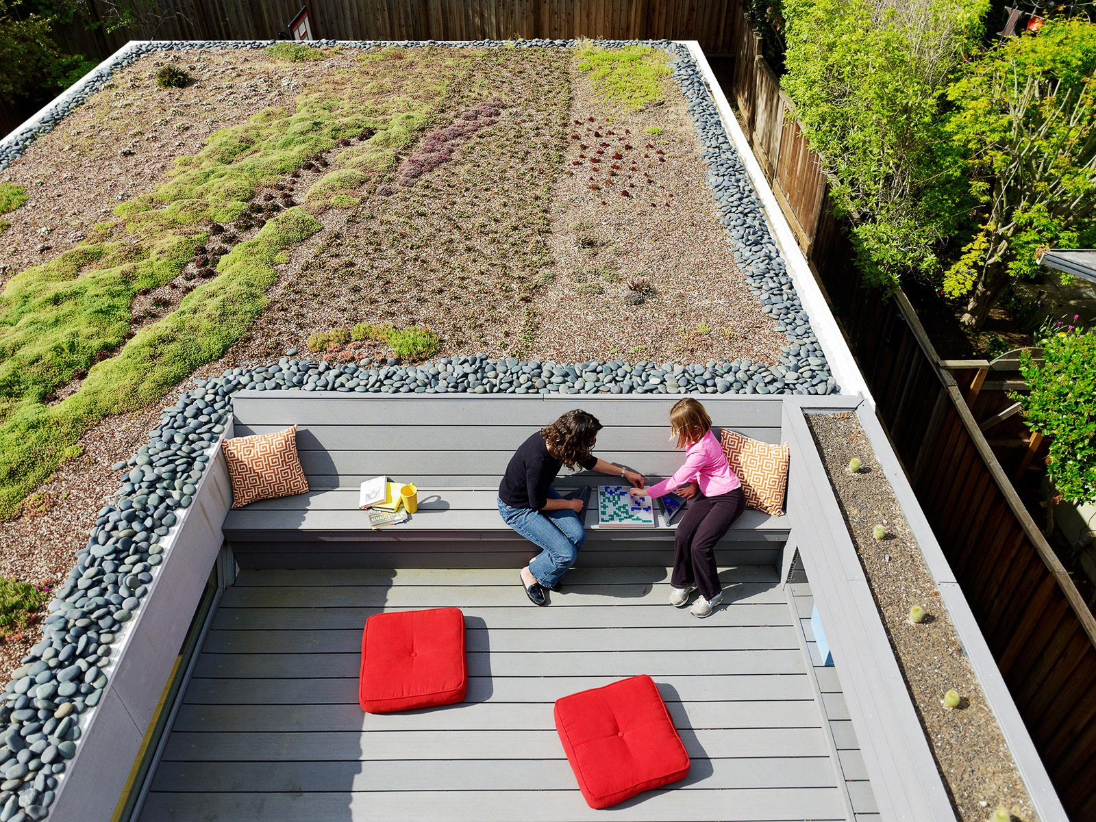 Rian and Melissa Jorgensen's 2 Bar House in Menlo Park boasts all the usual green design suspects: energy-efficient lighting, good insulation, renewable material finishes, radiant heat, and the roof is pre-wired for future PV panels. Still, one of the homeowner's favorite aspect of  green design is the living roof planted with succulents, aloe, viviums, and ice plants. Tagged: Exterior, House, and Green Roof Material.  Photo 6 of 12 in These 10 Green Roofs Bring Life—and So Much More—to These Modern Structures