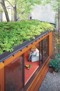 These 10 Green Roofs Bring Life—and So Much More—to These Modern Structures - Photo 3 of 11 - A green roof helps make up for lost garden space and creates a beautiful leafy view from the second and third floors. In summer, when the sliding doors are left wide open, indoor and outdoor spaces blend together.