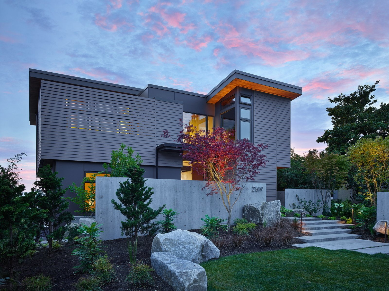 "This cozy urban retreat was designed to take advantage of Sound and Olympic Mountain views and highlight the owners' collection of NW art. A central steel + glass stair creates a ""vertical gallery"" filled with art and awash with natural light. On the top floor, living, dining and cooking spaces share two decks. One is secluded and captures morning light. The other opens up to sunsets and sweeping views.  Photo 6 of 12 in 11 of Our Favorite Pacific Northwest Homes From the Community"