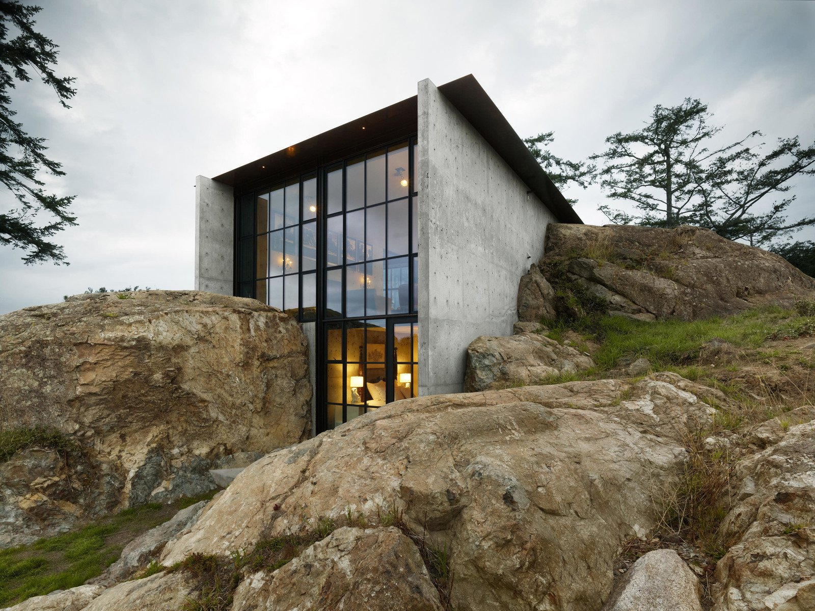 Conceived as a bunker nestled into the rock, the Pierre, the French word for stone, celebrates the materiality of the site. The owner's affection for a stone outcropping on her property and the views from its peak inspired the design of this house which from certain angles—almost disappears into nature.
