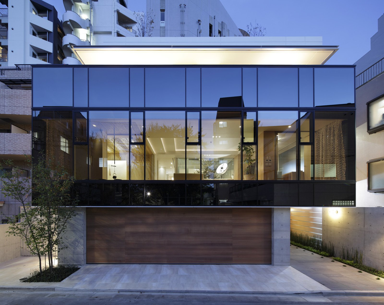 Glass is the star feature of this modernist home in Japan. Glass Takes Center Stage in These 10 See-Through Homes - Photo 10 of 11