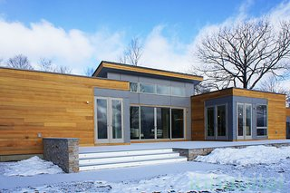 "10 Prefabs Found on the East Coast - Photo 7 of 10 - The ""Breezehouse"" is a 2,420-square-foot prefab home by Blu Homes in the Hudson Valley.  The soaring ceilings and open floor plan allow for spacious, light-filled rooms."