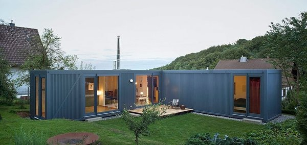 This modern prefab shipping container home in  Germany was designed by Cologne-based studio LHVH Architekten.