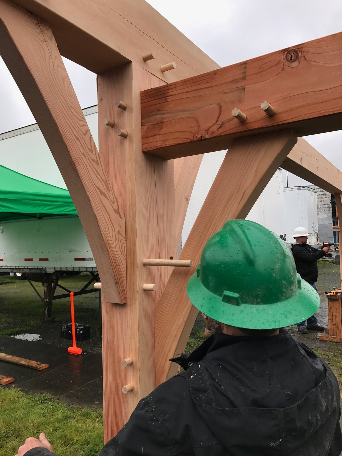 New Energy Works Timberframers event raised a structure with solar panels (from Snychro Solar) in place at the big timber event: Thinking Outside the Frame: Traditional Craft Melds with Modern Technology.