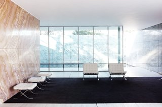 Less Is More: 10 Buildings by Ludwig Mies van der Rohe - Photo 2 of 10 - Designed by Mies van der Rohe as part of the 1929 International Exposition in Barcelona, Spain, The Barcelona Pavilion showcased his iconic Barcelona chair for Knoll and introduced architecture's new modern movement to the world.
