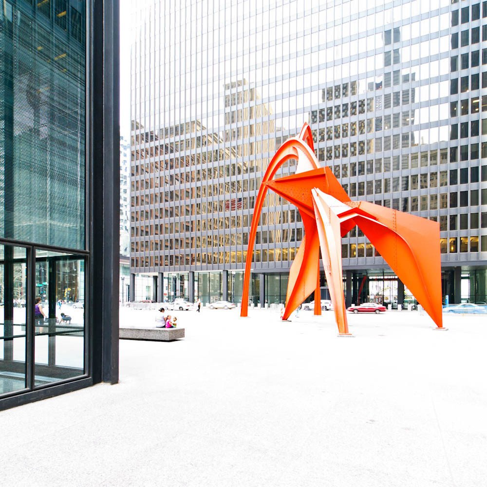 The Alexander Calder's striking 'Flamingo'  sculpture complimenting the linear complex.  Photo 4 of 11 in Less Is More: 10 Buildings by Ludwig Mies van der Rohe