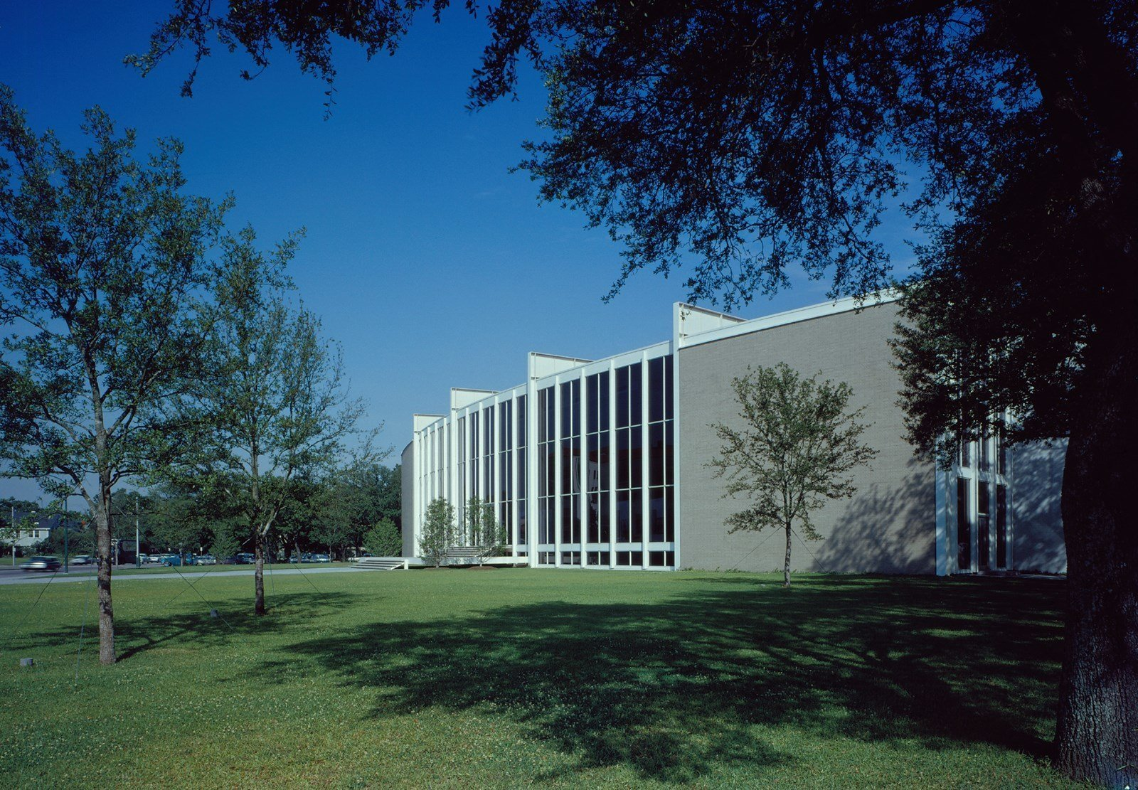 "In 1953, Nina J. Cullinan gifted a building addition to Houston's Museum of Fine Arts as a memorial for her parents. Her only stipulation was that it had to be designed by an architect of ""outstanding reputation and wide experience."" After being selected for the commission, Mies arrived in Houston on a hot summer day and rejected the idea of a standard open museum courtyard by remarking, ""But in this climate, you cannot want an open patio.""  Photo 10 of 11 in Less Is More: 10 Buildings by Ludwig Mies van der Rohe"