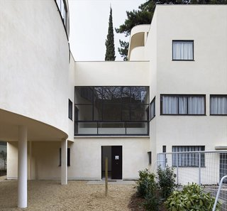 Spotlight on 10 Influential Works by Le Corbusier - Photo 1 of 10 - Villa Roche exemplifies Le Corbusier's modern approach to housing. Designed as a residence for Swiss banker Raoul La Roche, the Villa also served as an exhibition space for Mr. Roche's avant-garde collection of art—which beautifully integrating its purpose as both a residence and gallery space. Maison La Roche was designed in collaboration with Le Corbusier's cousin Pierre Jeanneret and is connected to Maison Jenneret. Both were named UNESCO Heritage Sites.