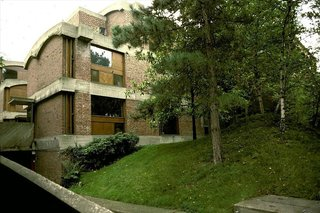 """Spotlight on 10 Influential Works by Le Corbusier - Photo 7 of 10 - Maisons Jaoul is pair of houses built for André Jaoul and his son Michel in the upscale Paris suburb of Neuilly-sur-Seine. A departure from his white squares, the homes are among Le Corbusier's most important post-war structures and feature unpainted cast-concrete—""""béton brut""""—together with rugged brickwork."""