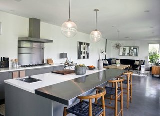 The house contains four bedrooms and two-and-a-half baths. The open kitchen is by Boffi.