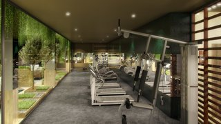 """The City of Lisbon Inspired the Design of This Surprisingly Luxurious Student Residence - Photo 4 of 7 - """"The use of foliage is our interpretation of 'greenery,' which is the Pantone color of the year—as it brings the same fresh feeling to the interiors"""". - Design Command. Pictured is the gym."""