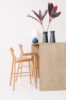 """We have a good assortment of local makers in the shop, but we also have artisans from all over that we have long-standing relationships with. So, if we have a customer that wants to custom-make a ceramic set, we have the relationship with the makers to do it,"" explained Person. Shown here are the barstools in oak from De Jong & Co."