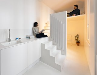 Gestalten's New Book Shows How to Transform Small Spaces Into Design Marvels - Photo 2 of 16 - The Spectral Apartment by Betillon/Dorval-Bory Architects is a renovation of a 215-square-foot flat on the outskirts of Paris. Designed around the need to maximize natural light, the all-white interior features a mezzanine with a stairway leading up to a sleeping nook that conceals the sink and shower below.