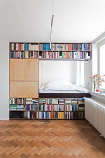Gestalten's New Book Shows How to Transform Small Spaces Into Design Marvels - Photo 11 of 16 - This renovation for a writer in Prague by BY Architects has slotted the bed behind a massive bookshelf in order to meet spatial requirements.