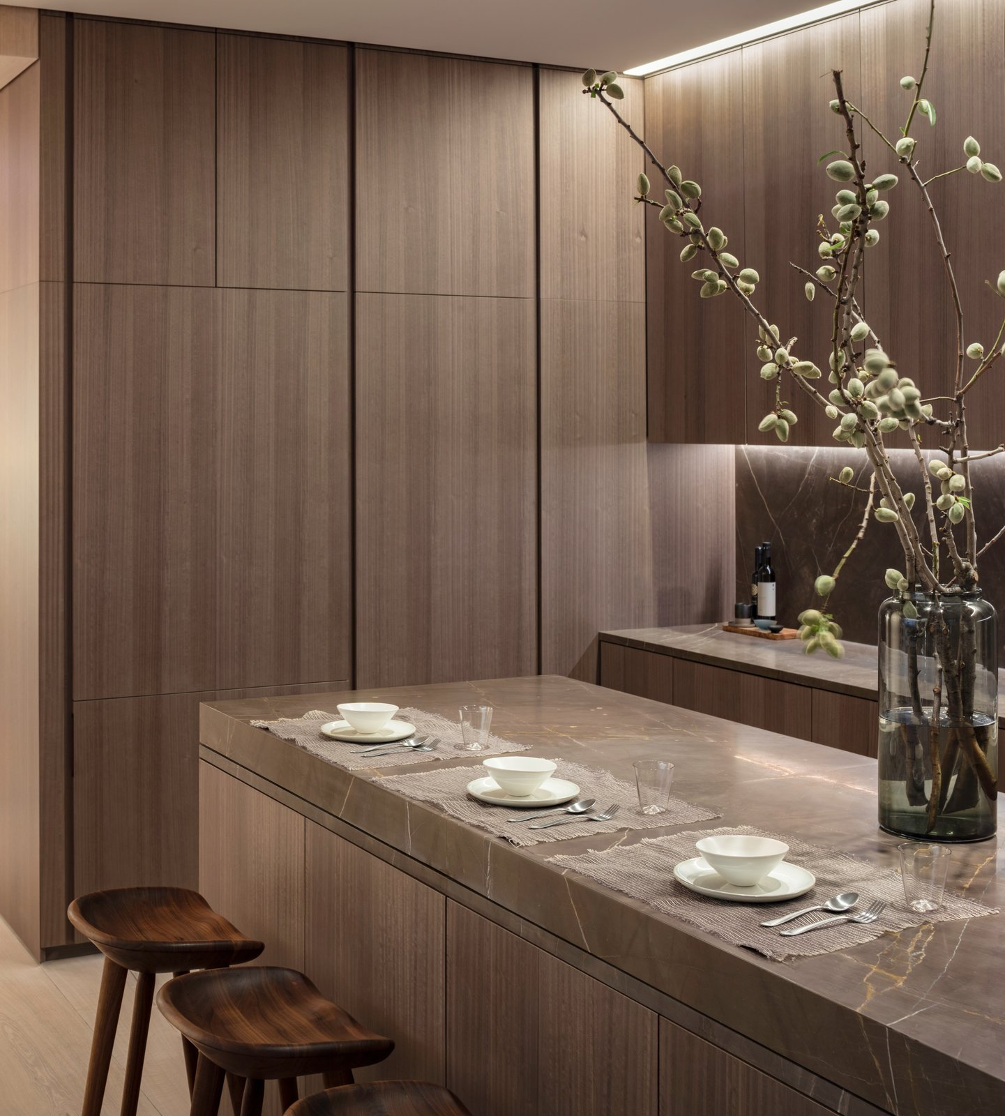 The kitchen offers enhanced flexibility with a custom sliding Fango marble countertop by the Italian brand Minimal.  Photo 5 of 10 in A Look Into NYC's 152 Elizabeth Street, Tadao Ando's First Residential Project Outside of Asia