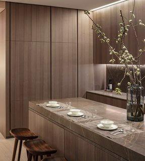 A Look Into NYC's 152 Elizabeth Street, Tadao Ando's First Residential Project Outside of Asia - Photo 4 of 9 - The kitchen offers enhanced flexibility with a custom sliding Fango marble countertop by the Italian brand Minimal.