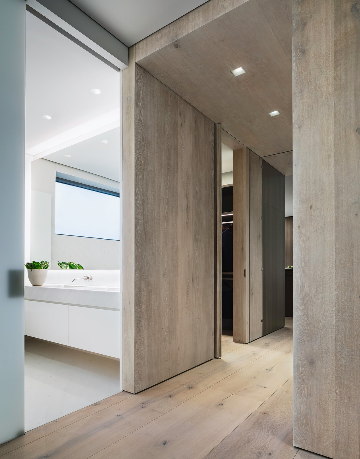 The flooring is comprised of wide-plank Danish oak from Dinesen, which is also featured in select wall panels and used to create the thick, full-height doors to the master bedroom.  Photo 8 of 10 in A Look Into NYC's 152 Elizabeth Street, Tadao Ando's First Residential Project Outside of Asia