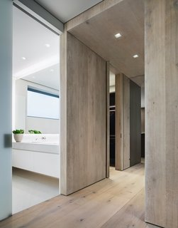 A Look Into NYC's 152 Elizabeth Street, Tadao Ando's First Residential Project Outside of Asia - Photo 7 of 9 - The flooring is comprised of wide-plank Danish oak from Dinesen, which is also featured in select wall panels and used to create the thick, full-height doors to the master bedroom.