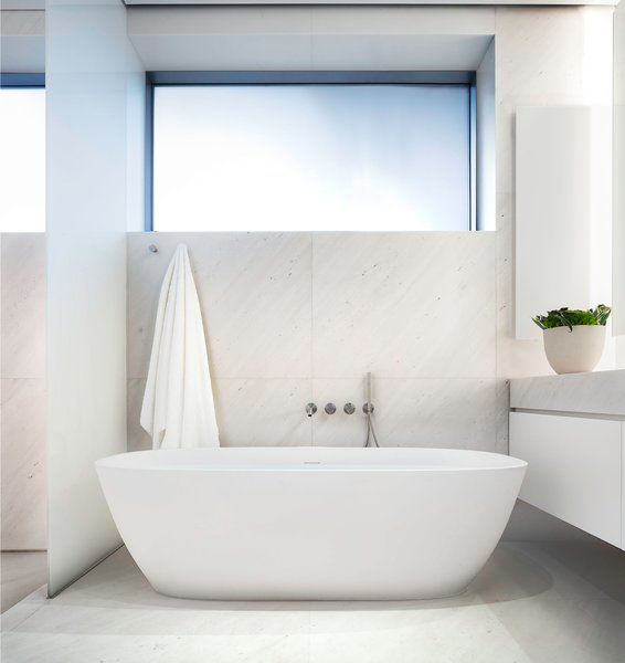 The bathrooms are inspired by spa chambers and include Japanese-style soaking tubs.