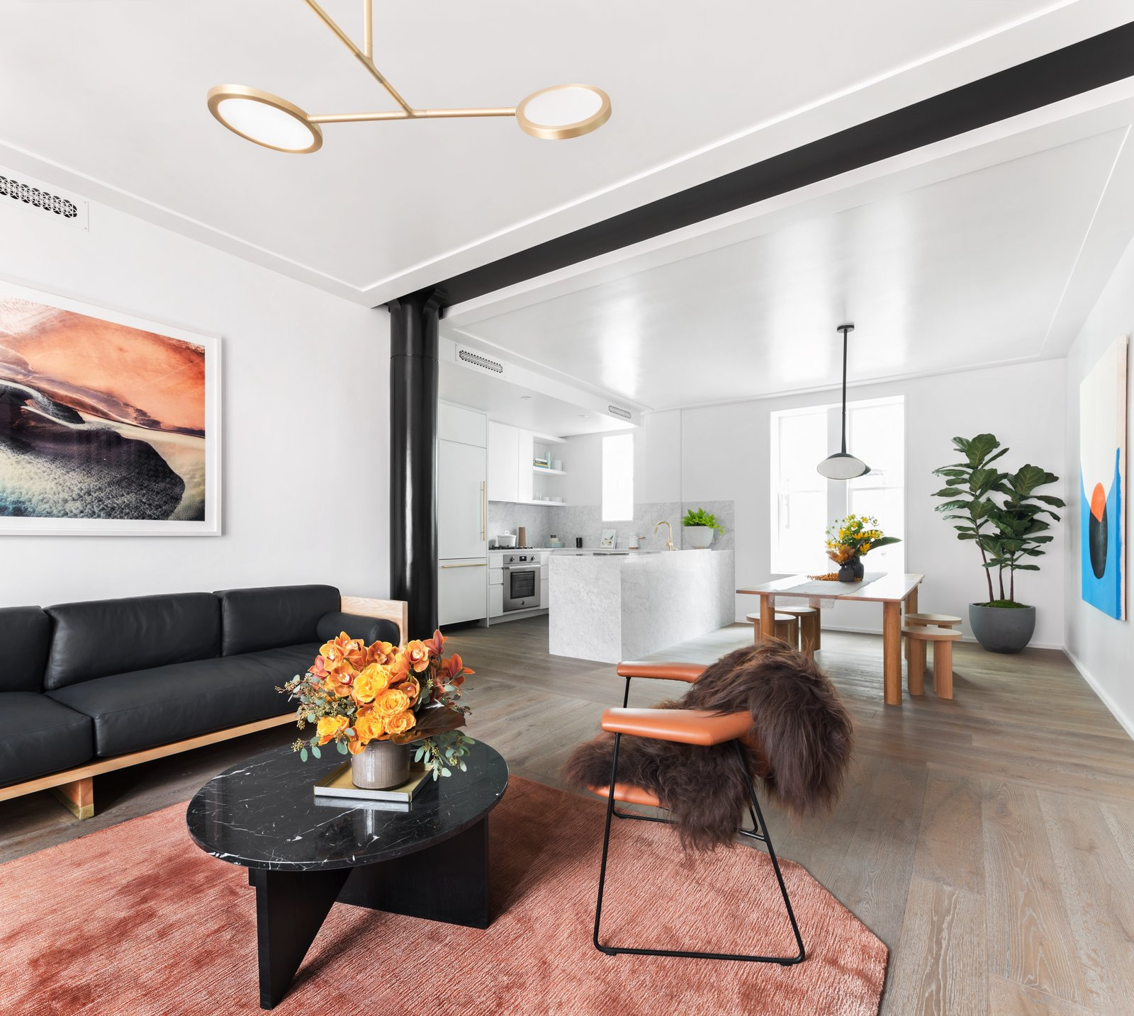 Matter Made's Affordances Coffee Table designed by Jonathan Zawada plays centerpiece of the well-appointed space.  Photo 4 of 9 in Formerly Home to Superman, The Standish Offers Modernized Beaux-Arts Condos From $1.3 Million