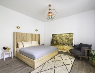 The master bedroom includes a stunning multicolor glass lighting fixture by New York-based lighting and product designer Bec Brittain, which creates a soothing ambiance and an artistic focal point in the room.
