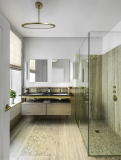 Formerly Home to Superman, The Standish Offers Modernized Beaux-Arts Condos From $1.3 Million - Photo 7 of 8 - The master bath features a rain shower, Fantini fixtures in natural brass, and accents in travertine and mosaic.