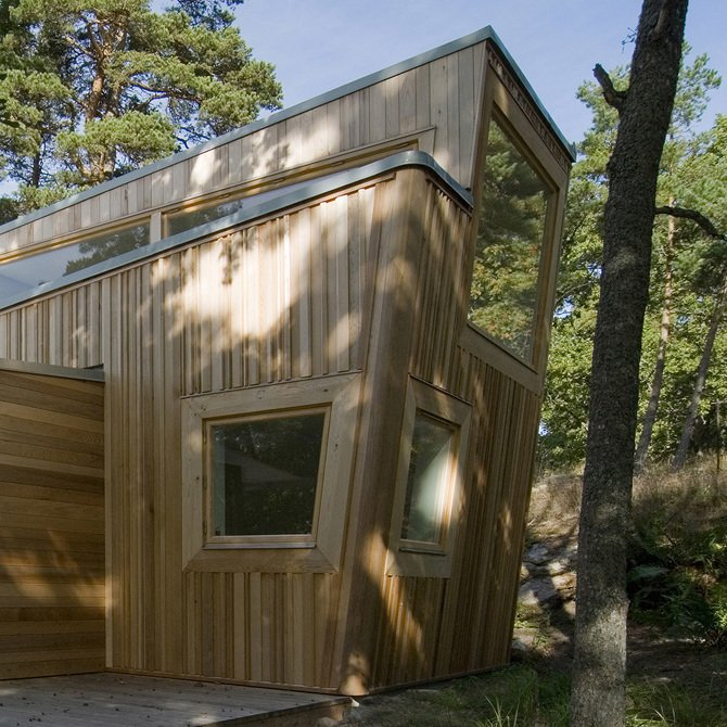 Built entirely of wood, this cabin in the forest of Ingarö was constructed in close collaboration with local builders and local woodworking companies and was inspired by its sylvan setting.  Photo 8 of 10 in A Look at 10 Minimalist Scandinavian Cabins