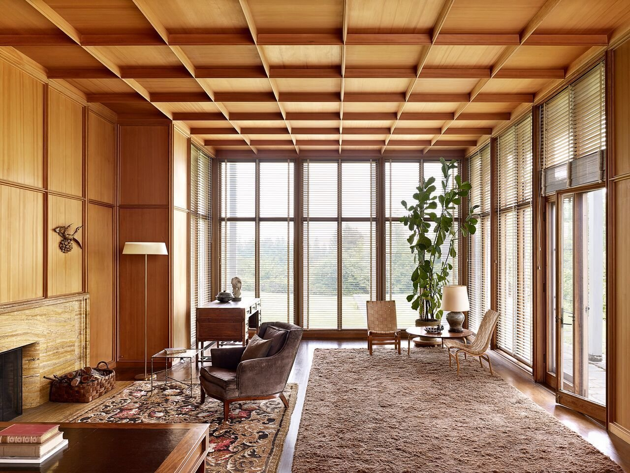 An interior view of the Watzek House living room. The wall panels conceal hidden closets.  Photo 5 of 15 in Spotlight on John Yeon, the Father of Northwest Regional Architecture