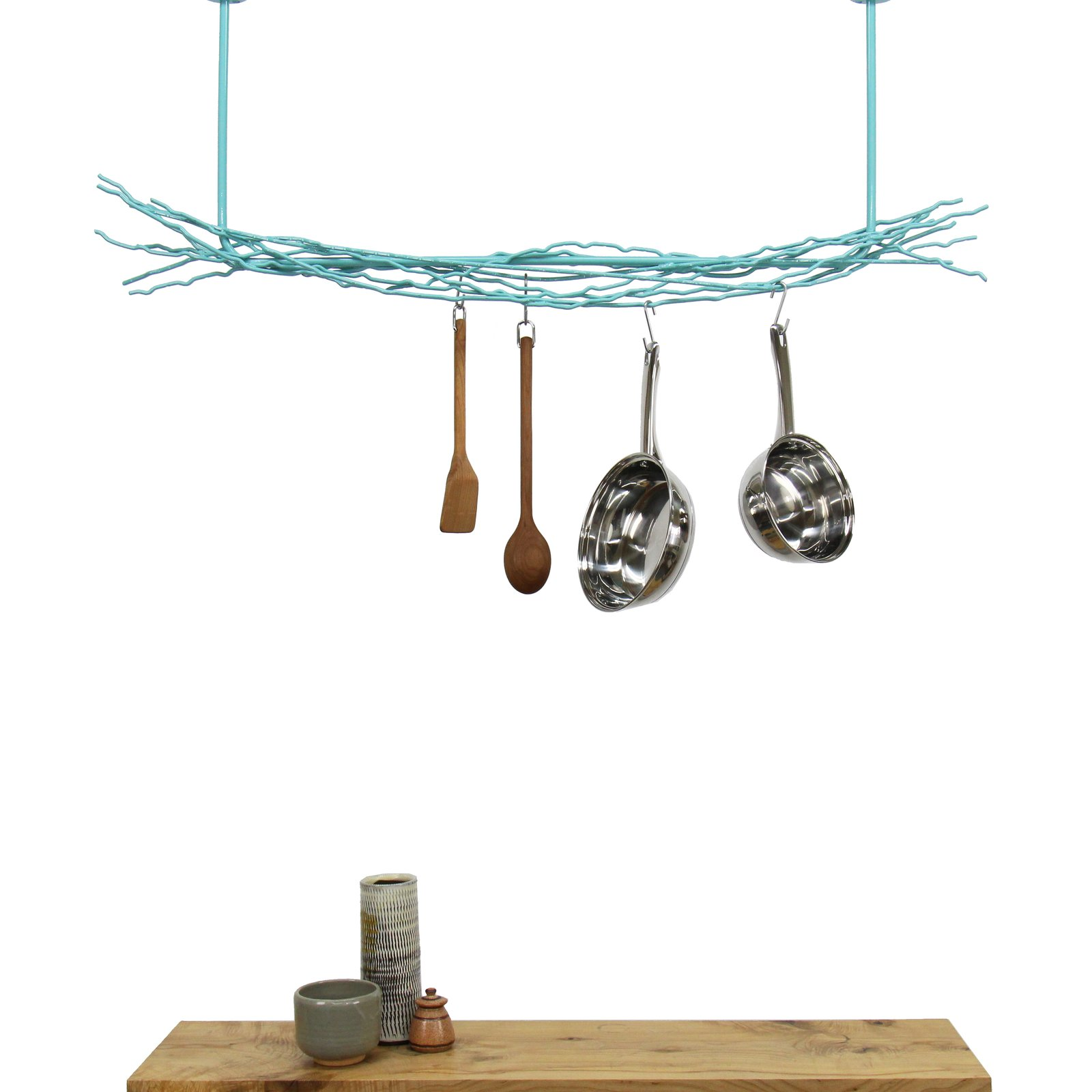 This modern pot rack from Merkled Studio is made from salvaged steel loom ends collected from a weaving company located only 10 blocks from the designer's studio. Able to hold even the heaviest cast-iron skillet, each organic piece has also been powder-coated for durability.  Photo 8 of 12 in 10 Functional Pieces For Small Space Living