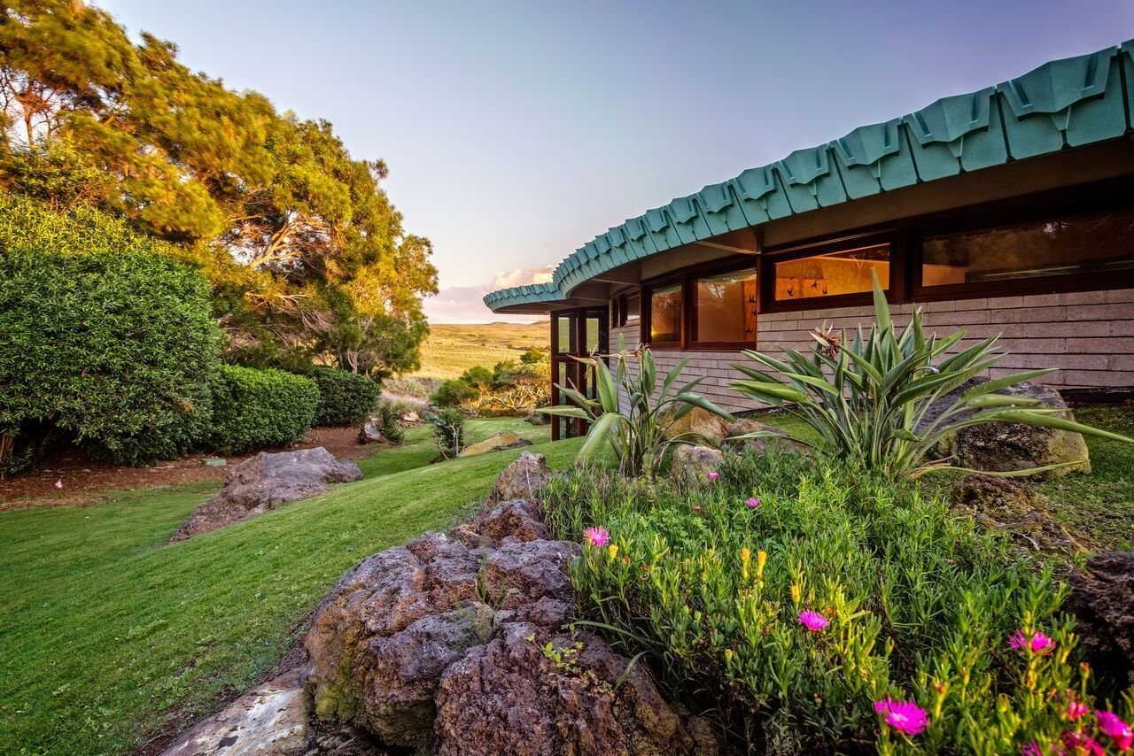 The only Frank Lloyd Wright-designed home in Hawaii captures not only the architect's signature style, but also the spirit of its location—with an outdoor lava-rock hot tub overlooking the ocean and breathtaking panoramic mountain views of three of the Big Island's awe-inspiring volcanoes (Mauna Kea, Mauna Loa and Hualalai). Completed in 1995, the home was commissioned by Sanderson Sims in partnership with Taliesin Associated Architects, John Rattenbury and the Frank Lloyd Wright Foundation to bring this never before built plan to life. Originally conceived for the Cornwell Family in Pennsylvania in 1954, the 3,700 sq. foot passive solar hemicycle home embodies Wrights's principles of organic architecture in which the structure blends harmoniously with the natural landscape.  Photo 7 of 11 in 10 Frank Lloyd Wright Homes Available to Rent Right Now