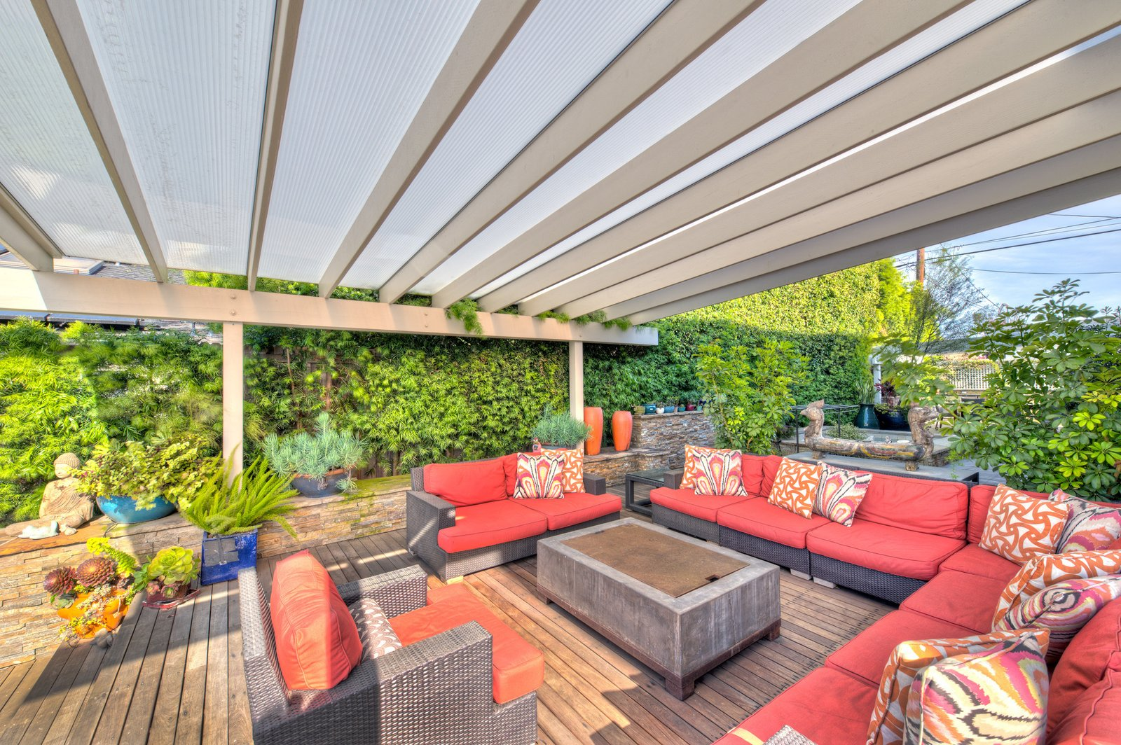 Equipped with outdoor living, kitchen and dining areas—and a stunning fire pit, the deck also boasts a built-in spa. Tagged: Outdoor. On the Market For $4.5M, This Venice Beach Compound Captures the Essence of Indoor-Outdoor Living - Photo 2 of 9