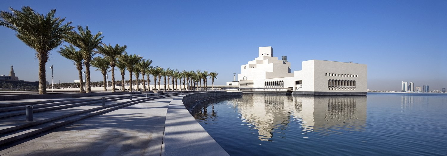 Standing apart on the waters of the Corniche, in the Qatari capital, Doha the Museum of Islamic Art draws influence from traditional Islamic architecture. A glass curtain wall on the north side offers panoramic views from all five floors of gallery space, and the structure—which is made of limestone and captures hourly changes in light and shade—has become an iconic presence in the region.