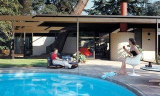 A Look at 10 Iconic Case Study Houses in California - Photo 4 of 10 - Saul and Dr. Ruth Bass poolside at Case Study House #20B in Altadena, California, 1958.