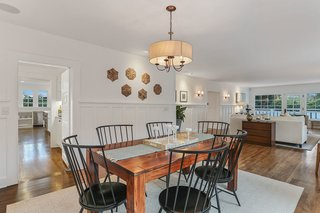 The dining room is adjacent to the living room and offers easy access to the kitchen and butler's pantry—perfect for entertaining.