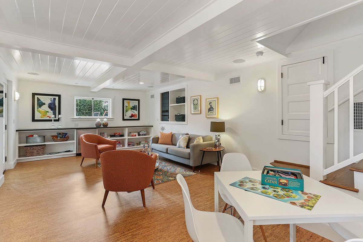 At the basement level, there is an additional family room with a half bath and access to the covered patio and gardens.